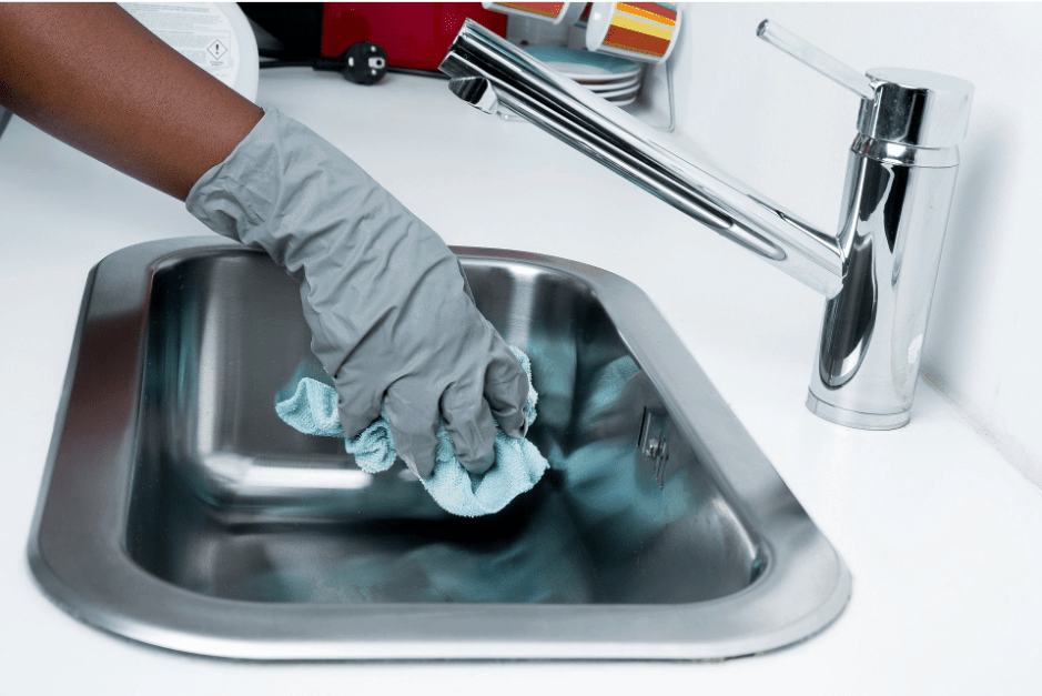 Cleaner cleaning a sink