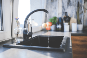 A picture containing Kitchen Tap, Kitchen Sink, Water