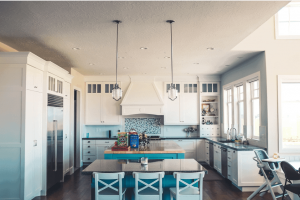 Light blue open plan kitchen living space
