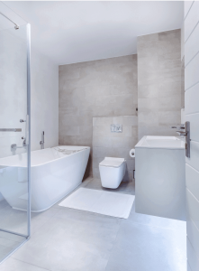 Grey and white bathroom with bath