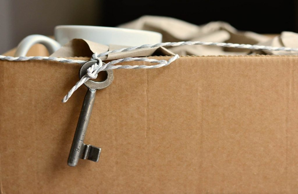 Box with string, key & tape