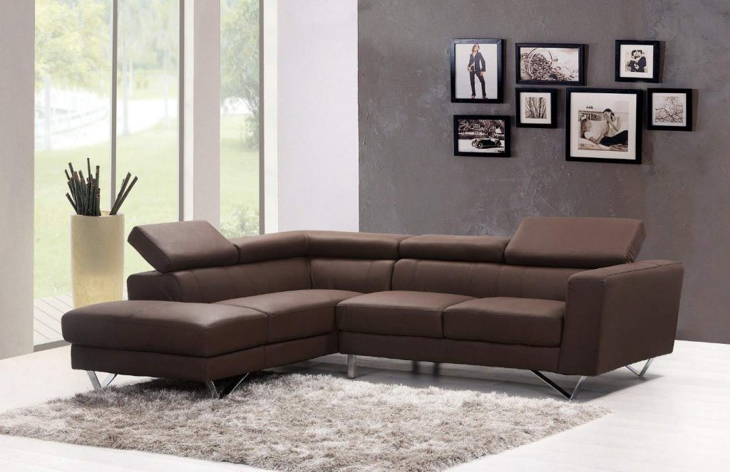 Large brown sofa in living room with grey pile carpet