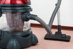 close up of vacuum cleaner on carpet
