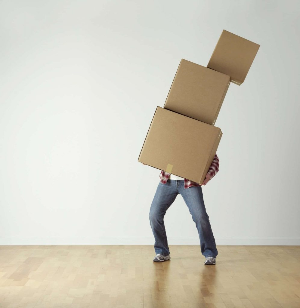 Man carrying 3 large empty boxes