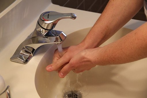 Man washing hands in sink