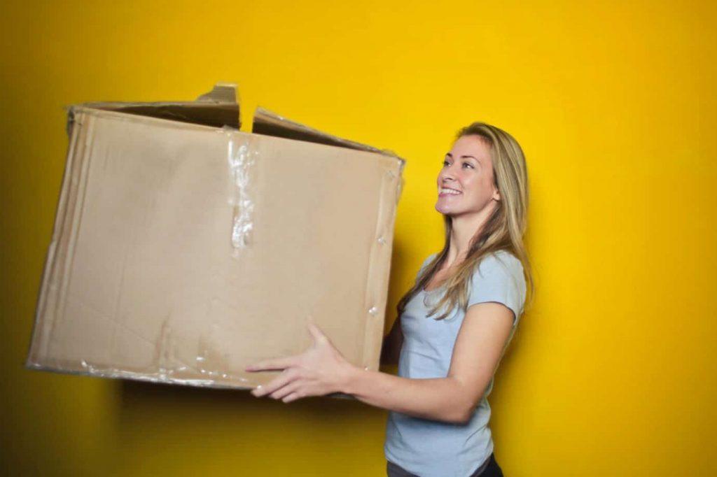 Women carrying a box