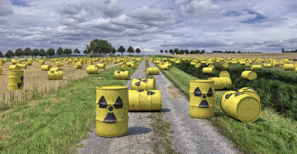 Yellow hazard barrels in countryside